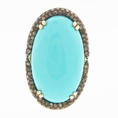This FABULOUS turquoise and brown diamond ring is incredible!!!  $2025