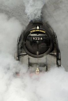 I love photos like this. The steam looks angry or dark at times but the train emerging looks so innocent and welcoming