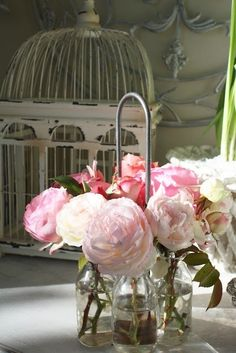 pink roses & peonies with chippy white birdcage:  shabby romantic cottage style