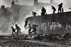 Don McCullin - Catholic youth escaping a CS gas assault in the Bogside, Londonderry, Northern Ireland This image links to the stimulus environment as it shows how some people survive in horrific conditions Londonderry, War Photography, Documentary Photography, Street Photography, Vintage Photography, Classic Photography, Storyboard, Story Inspiration, Writing Prompts
