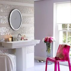 Love the sparkly accent wall in this airy bathroom!