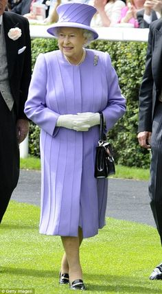 The Queen at Royal Ascot wearing a wool-crepe dress by her in-house couturier Angela Kelly, worn with matching hat and an amethyst brooch studded with seven purple stones and 12 freshwater pearls, gifted to her in 1960 after the opening of the Queen's Bridge in Scotland.