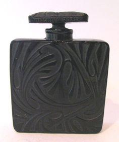 Bottle designed by Andre Jollivet, bottle made by Lalique.