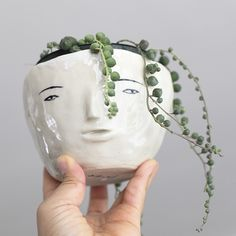 White ceramic head shape vase clay vessel pottery art artist Rami Kim | artnau