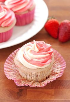 Fresh strawberry cupcakes topped with tangy cream cheese frosting and filled with a strawberry cheesecake surprise! No cake mix or jello needed!
