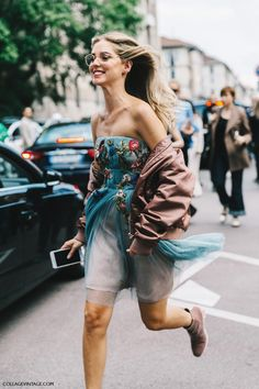 Chiara Ferragni Street Style - Bomber jacket, embellished tulle dress, and ankle boots.