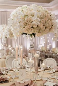 all white tall wedding reception centerpiece idea via jana williams photography