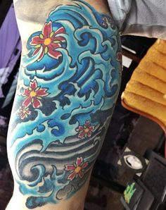 Leo has a tattoo of waves with a flower on his lower arm. It's in memory of his sister, Grace.