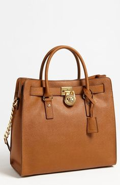 Free shipping and returns on MICHAEL Michael Kors 'Hamilton - Large' Saffiano Leather Tote at Nordstrom.com. Scratch-resistant Saffiano leather provides rich texture to a structured satchel embellished by a chunky monogrammed padlock. A chain-and-leather shoulder strap adds an elegant option to a timeless look.