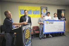 Michigan Powerball Winner | representing the RRRLB Club, shows reporters the $36 million winning ...