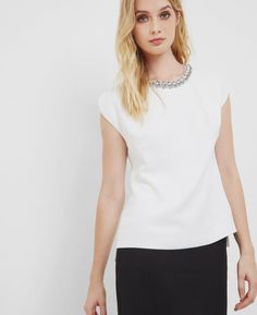 Embellished neckline top