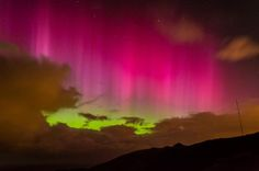 A spectacular aurora australis, or southern lights — the southern hemisphere's version of the northern lights — lit up the skies above New Zealand on Tuesday, as stargazers were treated to a dazzling bright-pink-and-green light show.