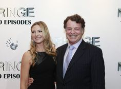 FRINGE 100TH EPISODE PARTY and FINALE EVENT: FRINGE Cast members Anna Torv and John Noble arrive on the red carpet during the FRINGE 100TH EPISODE PARTY and FINALE EVENT at the Fairmont Pacific Rim Hotel on Saturday Dec. 1st in Vancouver, British Columbia.  CR: Michael Courtney/FOX