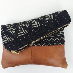 african mudcloth and leather fold over clutch by HouseofPillows on Etsy https://www.etsy.com/listing/271038437/african-mudcloth-and-leather-fold-over
