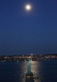 The Moon over the Statue of Liberty, New York - photo by Mario Tama/Getty Images, via Connecticut Post; of 55 New York Statue, A New York Minute, I Love Nyc, Land Of The Free, Our Lady, Belle Photo, Statue Of Liberty, New York City, New York Skyline