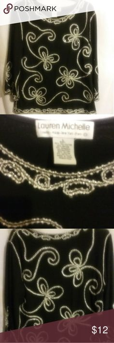 Lauren Michelle Top      65 Dressy top with shinny black sequins and eye catching silver trim/design. Perfect for a very special occasion. Tops Tunics