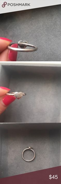 Coach heart ring Heart ring from coach. Beautiful dainty ring perfect for everyday wear!. Sterling silver, in great condition with no major or minor scratches or imperfections. Size 7 I believe. It fits my middle finger best but I have small hands. Please let me know if you have any questions! Coach Jewelry Rings