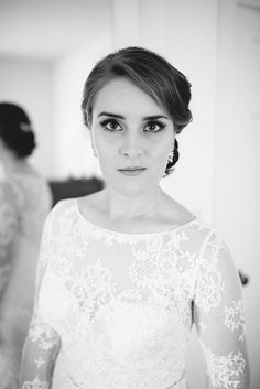 Iconic classic bridal portrait in black and white with all-over lace wedding dress