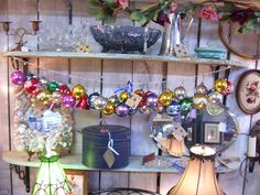 vintage ornaments - antique booth  I like the white wash wall shelf behind, create shelves.