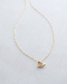 Tiny Gold Bird Necklace by Olive Yew.