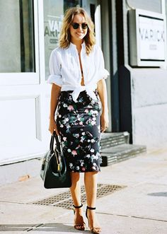 A white button-down is tied at the waist and worn with a floral pencil skirt and heels