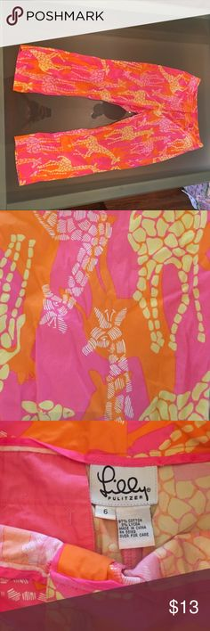 Lilly Pulitzer capris Pink and orange giraffe patterned capris. Great condition, authentic Lilly Pulitzer Pants Capris