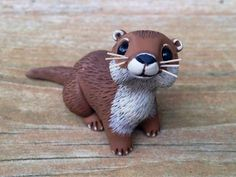 River Otter: Handmade miniature polymer clay animal figure USD) by Animal… Sculpey Clay, Polymer Clay Kunst, Polymer Clay Figures, Polymer Clay Sculptures, Cute Polymer Clay, Polymer Clay Animals, Cute Clay, Polymer Clay Projects, Polymer Clay Charms
