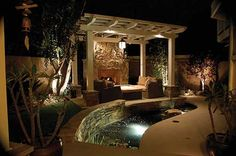 The Koi pond is the centerpiece of the backyard, it is encompassed by an outdoor living room with a fireplace, a barbeque cook center, dining area and landscaped yard including three trees