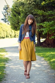 Girl and Closet: She is always so cute! I would never have thought to pair mustard and hot pink.