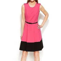 Calvin Klein color block sheath dress Pink and black color block seamed dress in size 2P. Lined. Button detail at shoulders. Hidden back zip closure. Hits knee level. Pleated with black belt Calvin Klein Dresses