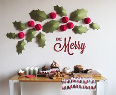 Free printable holiday holly wall be merry by SNOW & GRAHAM. Like the dimensional leaves and berries