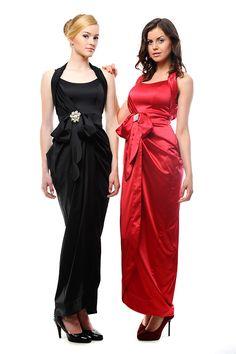 Стильное платье с двойными широкими брителями и низом на запах, украшенное бантом. Прекрасное платье из шелка-стрейча. Данное изделие поможет быть на высоте на любом мероприятие.