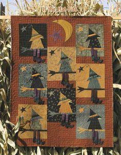 """Buggy Barn pattern ~ """"If The Hat Fits"""" halloween witch wall hanging quilt. I actually got this done in time for Halloween! (The leetle legs & boots dangle.)"""