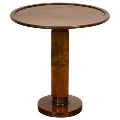 "Small mahogany gueridon called ""Smoker table"", circa 1936, by Jules LELEU (1883-1961), with a circular edged top resting on a square shaft on circular base. Maison Leleu was quite acute in creating such small side-tables for his clients, w/ varnished or lacquered wood, useful and complementary pieces to its furniture sets. (hva)"