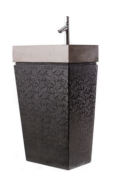 ANDROMEDA – Unique standing basin in two pieces (washbasin and stand) with normal drain, produced in custom sizes; comes with flower patterned, downward shrinking design stand. Size:L.55cm,W:35cm,H:90cm.