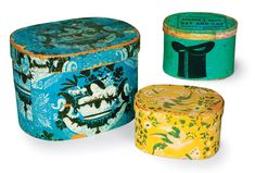 Front: a vibrant blue Hanna Davis example, 12 inches across; a more delicately patterned yellow box by Hannah Davis, measuring 6 by 12 inches. Back: green top-hat box, 9 by 13 inches, made by William Griffiths & Son of Boston for Furrier & Bean, hat manufacturer of Belfast, Maine.