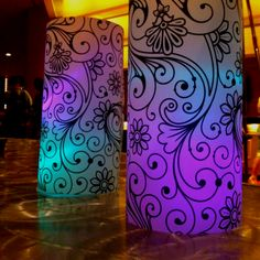 Simple party decor: heavy vellum 11 x 17 printed with scrolls. Inside are simple LED lights. One color place on ground then clear solo cup...