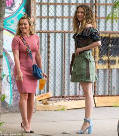 Leggy: Sutton showcased her gorgeous gams in an olive green military mini skirt that rode high on her waist