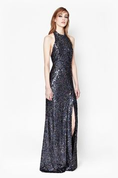 3d48ad328f0 Dazzle people with your charm in this floor-sweeping Lunar Sparkle Sequin  Maxi Dress with stretch halter neck