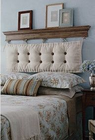 By hanging a chaise cushion from a shelf....voila! A DIY headboard! Buttons and bows can be added for more personality and a pop of color too!