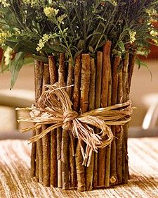 Martha is always looking for unusual containers for flower arrangements. Recently, she fashioned a natural-looking vase from a coffee can and twigs gathered during a walk in the woods. Tied with a length of raffia, it makes a charming holder for garden flowers or a rustic desk organizer.