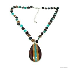 Natural Hammer Shells dyed in alluring colors make up this lovely necklace ensemble created by artisan, Carol. The shells forming the teardrop pendant are individually hand painted exuding a tropical and exotic appeal.  ~Modern Teardrop Hand Painted Hammer Shell Necklace~  SKU: NS-0143-Mix