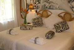 Bhangazi Lodge offers four comfortable double guest bedrooms, each with an en-suite bathroom and a private terrace and entrance.