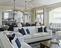 Family room - blue and white; navy piping on couch, pale blue ceiling and molding