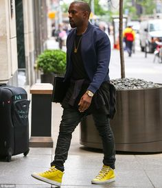 Nice Kanye. Those sneakers really work! Balenciaga of course!
