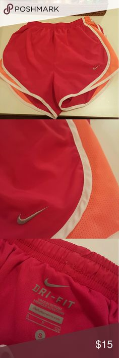 Nike DryFit Tempo Shorts NWOT Accidentally bought small instead of medium - never worn! Color is off in photo as these are more of a purply pink magenta color with neon pink accent. Nike Shorts
