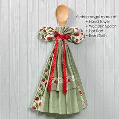 This clever angel makes a lovely kitchen brightener. Hang on the wall, or pull apart to make use of the cooking essentials in this set. Cotton, machine washable hand towel, dish cloth, and matching hot pad are accompanied by a handy wooden spoon. Towel is 10 x 19. Imported. Color may vary.