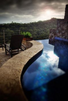 DCE   Maybe have some sort of infinity hot tub on the balcony of my master bedroom. Has a waterfall that falls into the hot tub above the cave.  #AndrewsIdeas