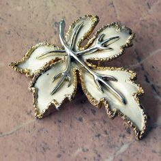 This elegant vintage leaf brooch has cream and gold detail Vintage Exquisite jewellery circa sixties Nice unusual detail to this single leaf edging,