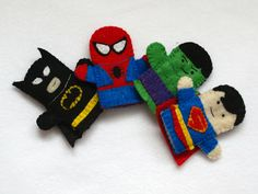 Batman, Superman, Spiderman and Hulk fingerpuppets, handmade by Joanne Rich.